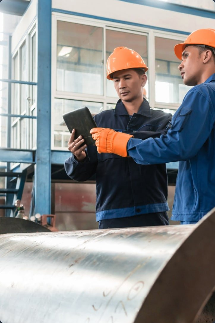 Industrial workers using tablet